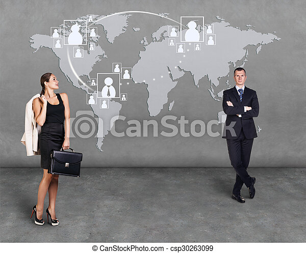 Businessmen standing in front of an earth map - csp30263099