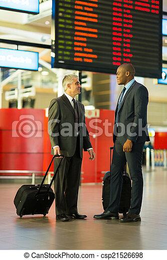 businessmen travelling together - csp21526698