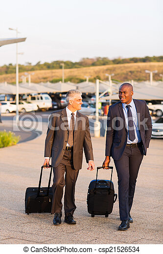 businessmen walking in airport parking lot - csp21526534