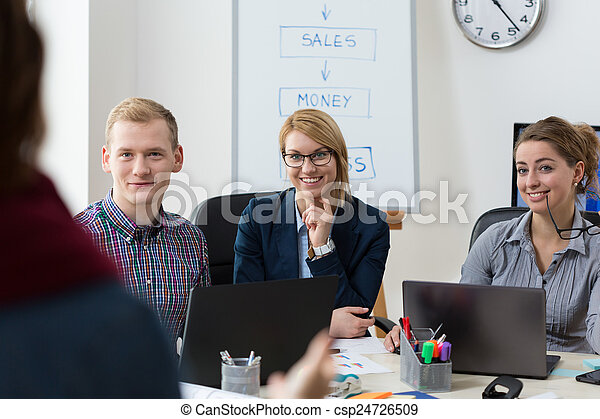 Businesspeople discussing with client - csp24726509