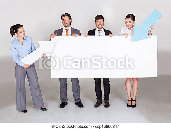 Businesspeople Holding Placard - csp16686247