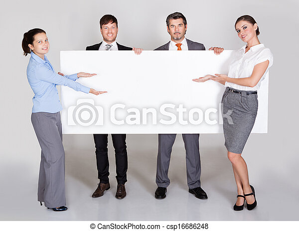 Businesspeople Holding Placard - csp16686248