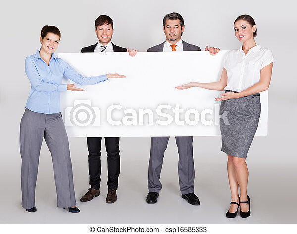 Businesspeople Holding Placard - csp16585333