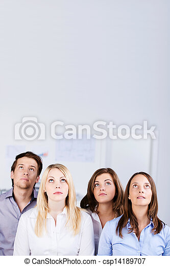 Businesspeople Looking Up In Office - csp14189707