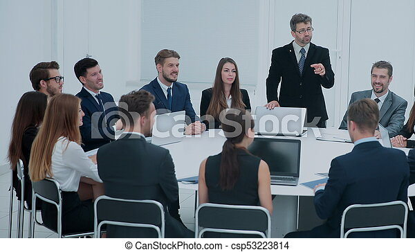 Businesspeople Sitting At Conference Round Table At The Meeting - 14 person conference table