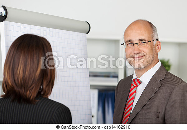 businesspeople standing by flipchart - csp14162910