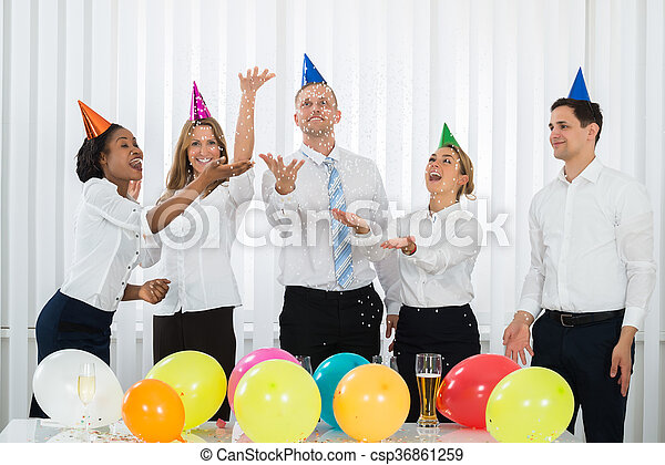 Businesspeople Standing Under Falling Confetti - csp36861259