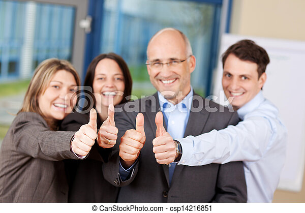 Businesspeople With Thumbs Up Sign In Office - csp14216851