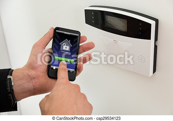 Businessperson Arming Security System - csp29534123