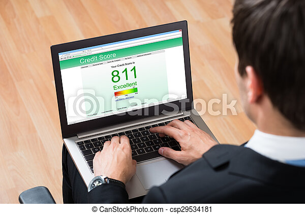 Businessperson Checking Online Credit Score Record On Laptop - csp29534181