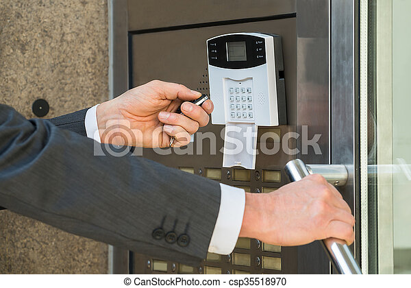Businessperson Hand Operating Security System - csp35518970