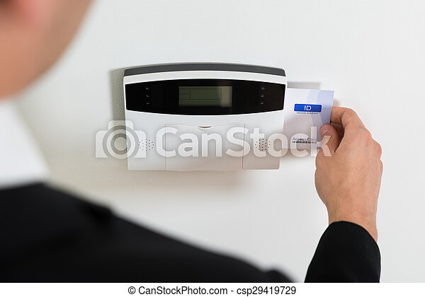 Businessperson Hands Inserting Keycard In Security System - csp29419729
