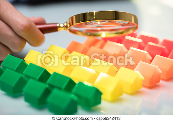 Businessperson Holding Magnifying Glass - csp56342413
