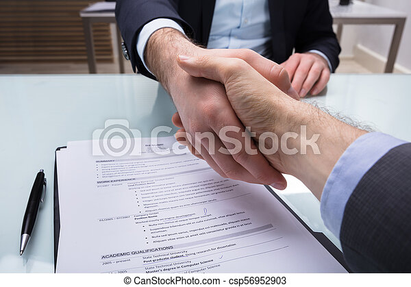 Businessperson Shaking Hand With Applicant - csp56952903
