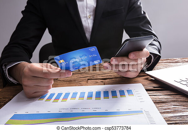 17c6c338de2 Businessperson Shopping Online With Mobile Phone And Credit Card -  csp53773784