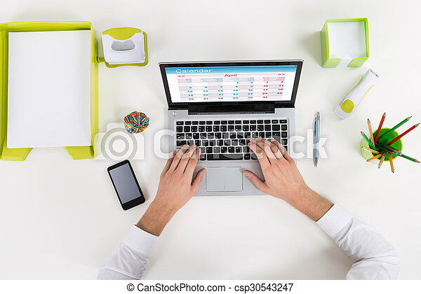 Businessperson Using Calendar On Laptop - csp30543247