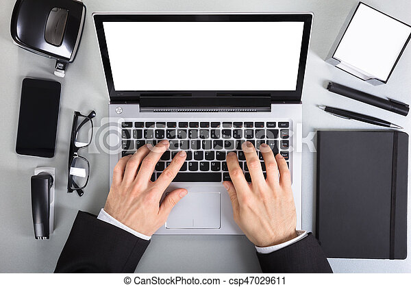 Businessperson Using Laptop - csp47029611