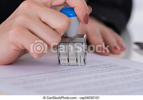 Businessperson Using Stamper On Document - csp34030101