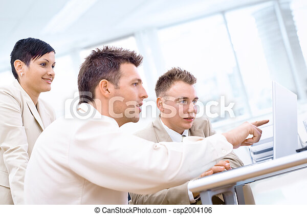 Businessteam with laptop - csp2004106