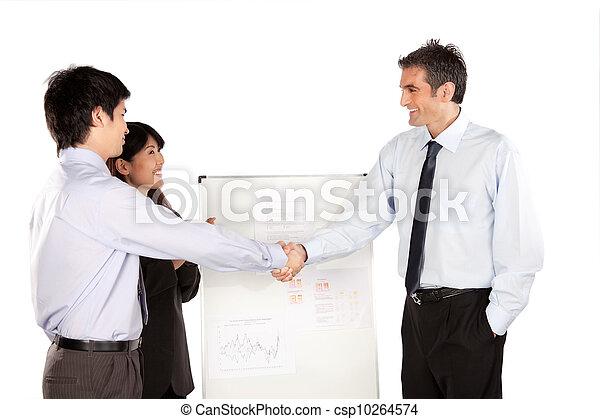Businesswoman and Businessman Shaking Hand - csp10264574