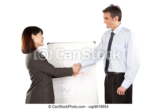 Businesswoman And Businessman Shaking Hand - csp9916654