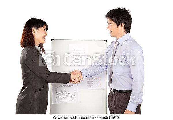 Businesswoman and Businessman Shaking Hand - csp9915919