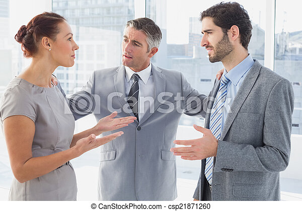 Businesswoman arguing with co-worke - csp21871260