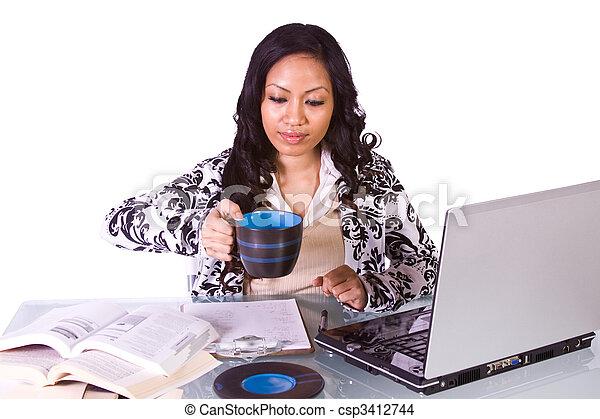Businesswoman at Her Desk Working - csp3412744