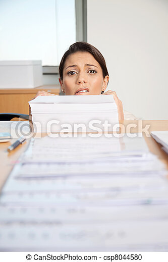 Businesswoman Behind Pile Of Paper - csp8044580