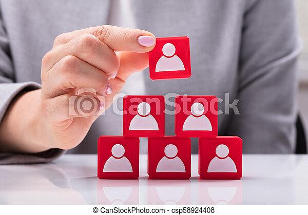 Businesswoman Building Blocks Of A Team - csp58924408