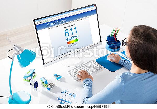 Businesswoman Checking Credit Score On Computer - csp46597195
