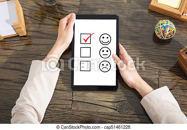 Businesswoman Checking Online Credit Score - csp51461228