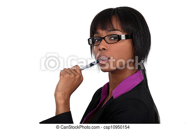 Businesswoman chewing on her pen - csp10950154
