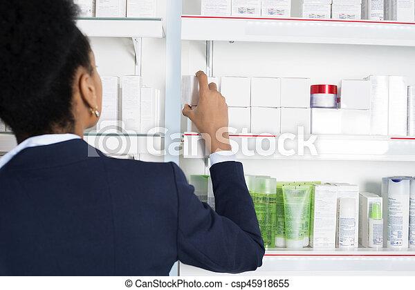 Businesswoman Choosing Medicine In Pharmacy - csp45918655