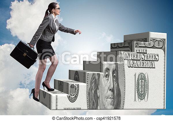 Businesswoman climbing dollar ladder concept - csp41921578