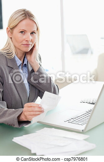 Businesswoman doing her accounting - csp7976801