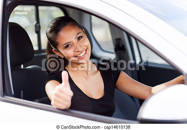 businesswoman giving thumb up inside new car - csp14610138