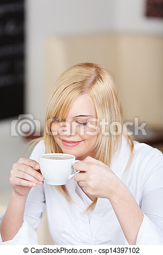 Businesswoman Having Coffee In Office Cafe - csp14397102