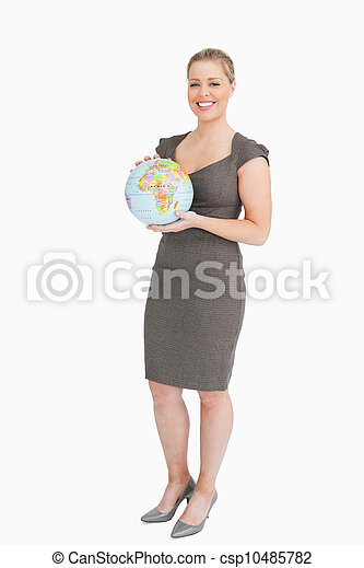 Businesswoman holding a globe in her hands - csp10485782