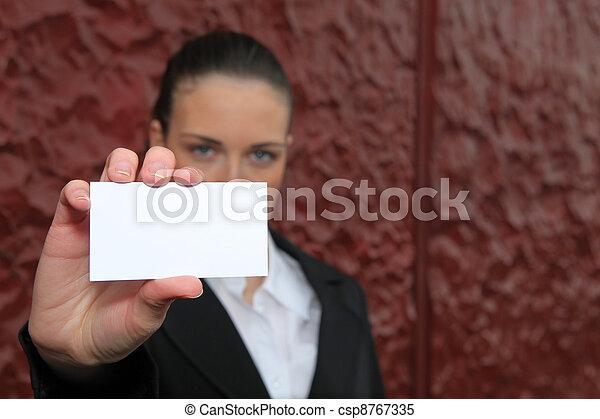 businesswoman holding a visit card - csp8767335