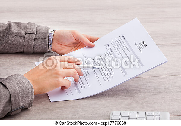 Businesswoman Holding Contract Paper - csp17776668