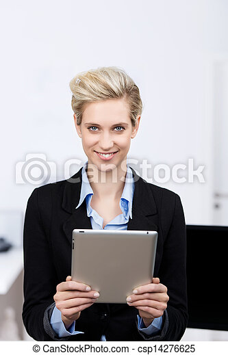 Businesswoman Holding Digital Tablet In Office - csp14276625