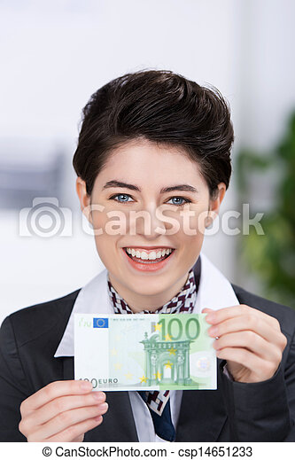 Businesswoman Holding Hundred Euros Banknote In Office - csp14651233