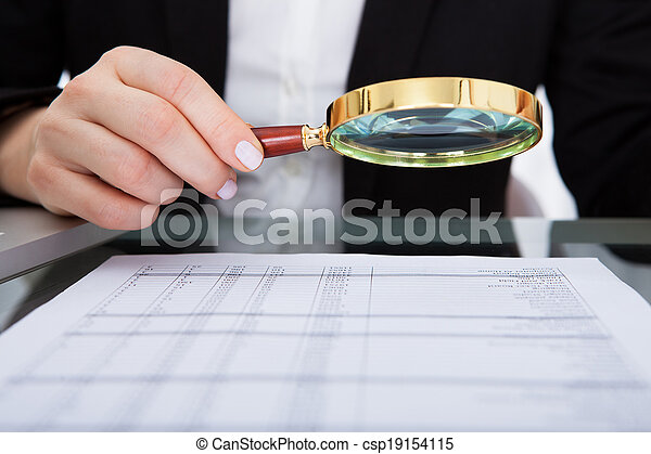 Businesswoman Holding Magnifying Glass - csp19154115