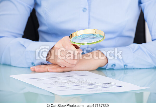 Businesswoman Holding Magnifying Glass - csp17167839