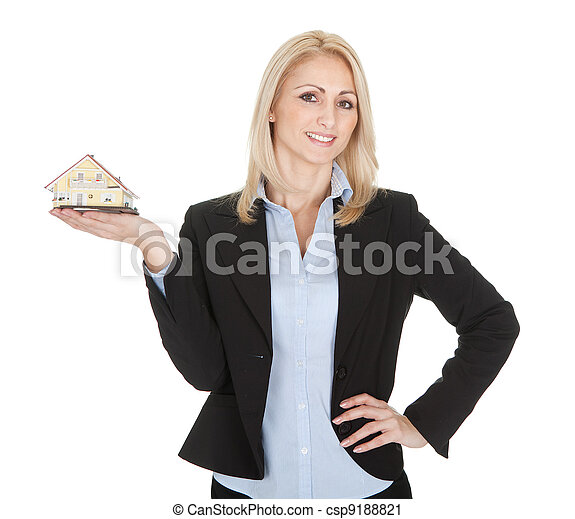 Businesswoman holding model of a house - csp9188821