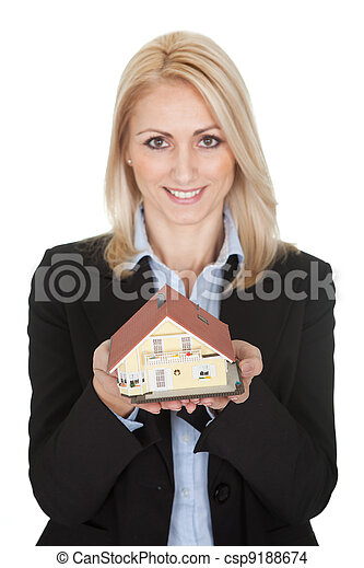 Businesswoman holding model of a house - csp9188674