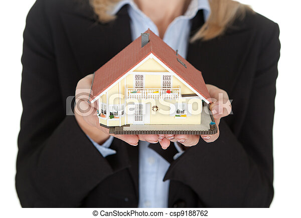 Businesswoman holding model of a house - csp9188762