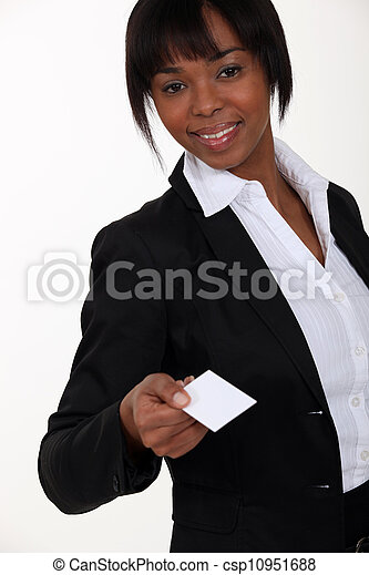 Businesswoman holding out card - csp10951688
