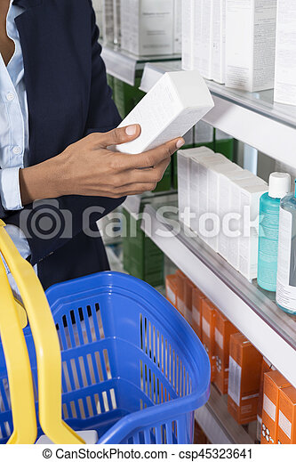 Businesswoman Holding Product In Pharmacy - csp45323641